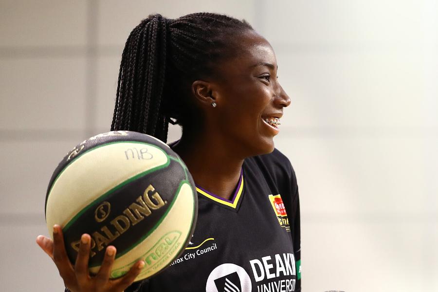 Ezi Magbegor smiling with basketball